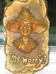 """Me, worry?"" Plaque by A. E. Mitchell"