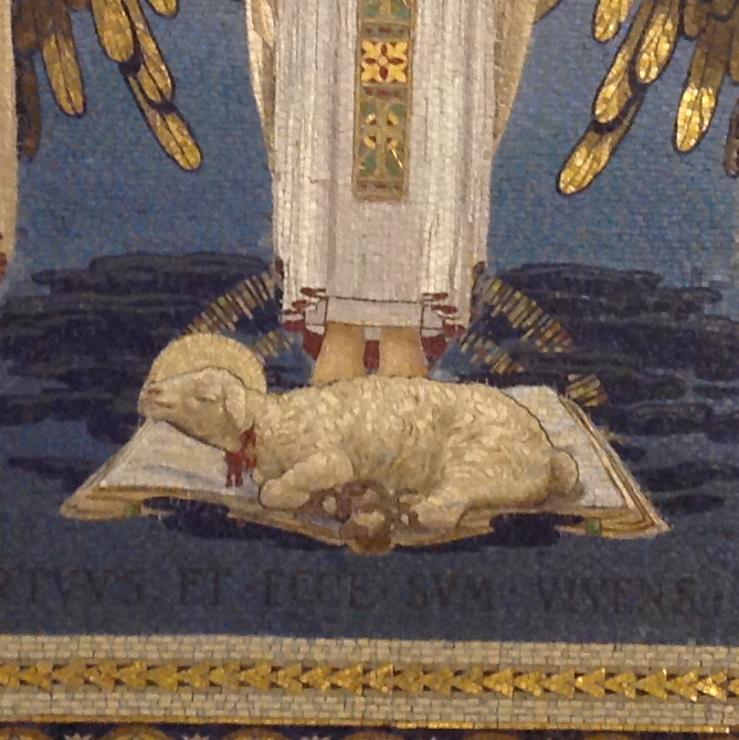 Lamb of God lying on an open Bible at the foot of an angel. Mosaic, Mt. Tabor.