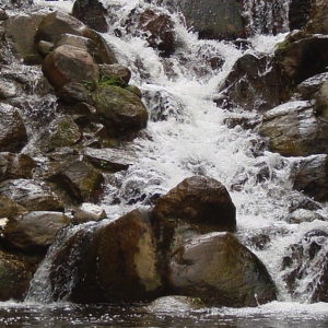 This is a waterfall splashing down on a big rock